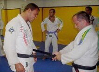Abreu receiving his black belt on Dec. 2004
